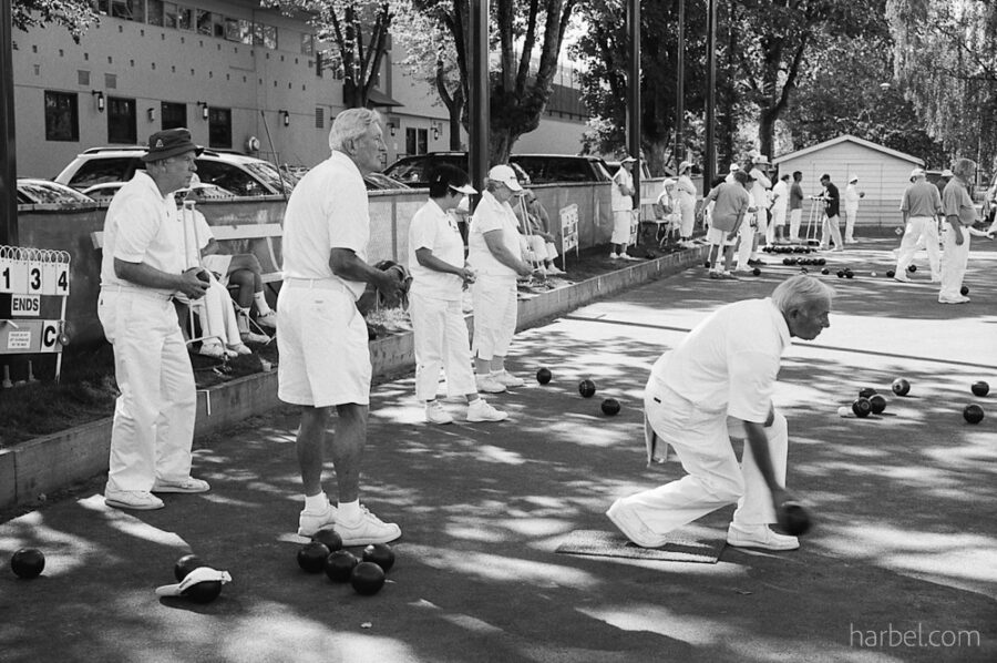 Harbel Photography, The Many - Lawn bowls in Vancouver. Lawn Bowls: Roll biased balls so that they stop close to jack. Vera Fotografia